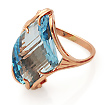 Золотое кольцо с голубым топазом SL-0243-501 весом 5 г  стоимостью 28000 р.